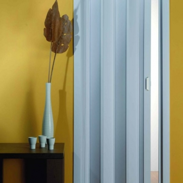 Porta a soffietto con pannelli in pvc col. bianco senza vetrini-1